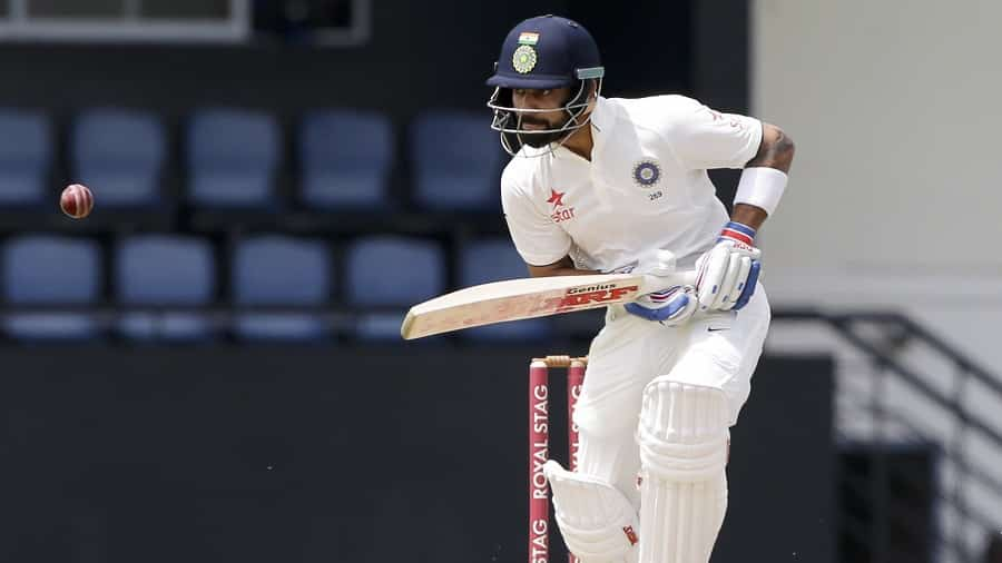 India's captain Virat Kohli plays a shot bowled by West Indies' Shannon Gabriel on day one of their third cricket Test match at the Daren Sammy Cricket Ground in Gros Islet, St. Lucia, Tuesday, Aug. 9, 2016. (AP Photo/Ricardo Mazalan)