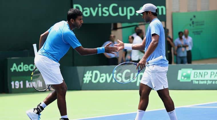 India's Rohan Bopanna, left, and Leander Paes shake hands during their doubles tennis match against Czech Republic's Adam Pavlasek and Radek Stepanek in the Davis Cup World Group play-off tie in New Delhi, India, Saturday, Sept. 19, 2015. The Czech Republic defeated India 5-7, 2-6, 2-6. (AP Photo/Altaf Qadri)