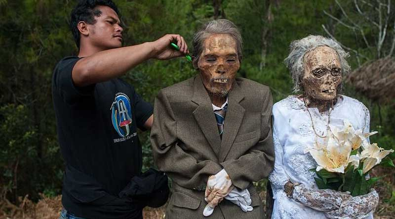 Indonesian villagers celebrate a bizarre festival as ritual with dead bodies