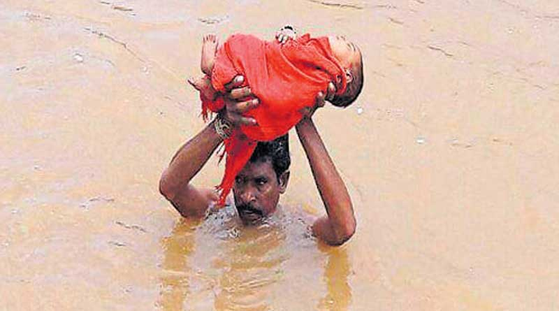 Father swims across the river to take sick infant to hospital