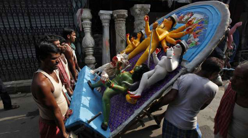 Labours who carry the idols of Goddess Durga
