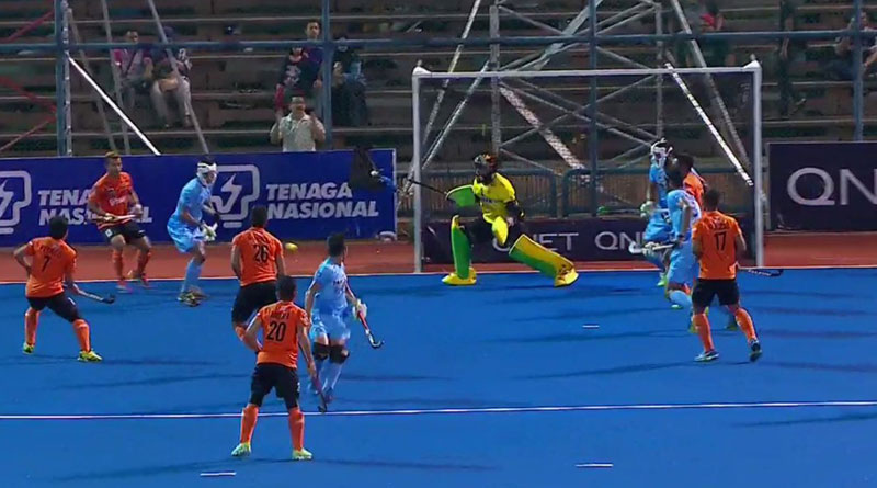 India beat Malaysia 2-1 to finish at the top of the points table