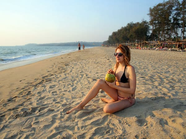 goa_goa_woman-sipping-coconut-water-on-a-beach-in-goa