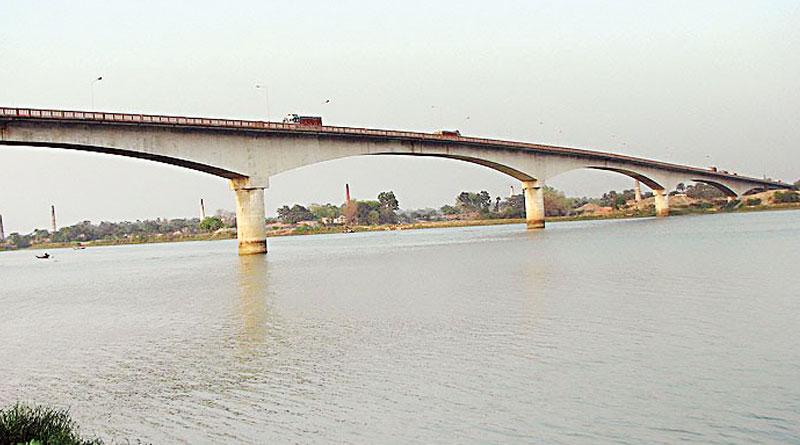 Ishwar Gupta Setu is leaning dangerously over the river ganges