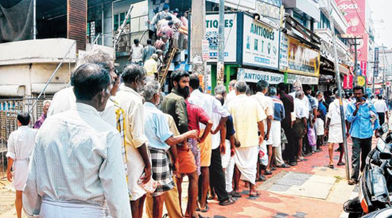 People of TN gathered before liquor shops when Amma suffers in hospital
