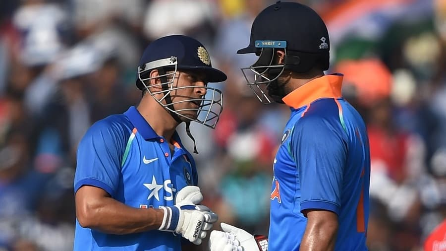 India's Yuvraj Singh (R) and Mahindra Singh Dhoni bump gloves during the second One Day International cricket match between India and England at the Barabati Stadium in Cuttack on January 19, 2017.----IMAGE RESTRICTED TO EDITORIAL USE - STRICTLY NO COMMERCIAL USE----- / GETTYOUT / AFP PHOTO / Money SHARMA / ----IMAGE RESTRICTED TO EDITORIAL USE - STRICTLY NO COMMERCIAL USE----- / GETTYOUT