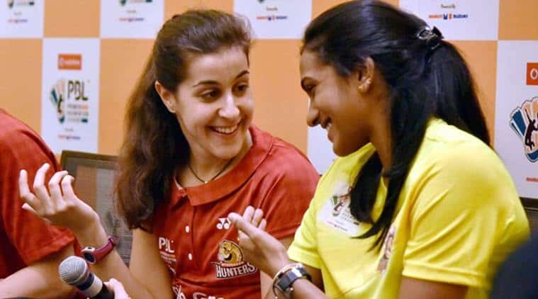 Hyderabad: Ace shuttler P V Sindhu and Spain's Carolina Marin chat at a press conference of the the Premier Badminton League (PBL) in Hyderabad on Friday. PTI Photo(PTI12_30_2016_000214B)