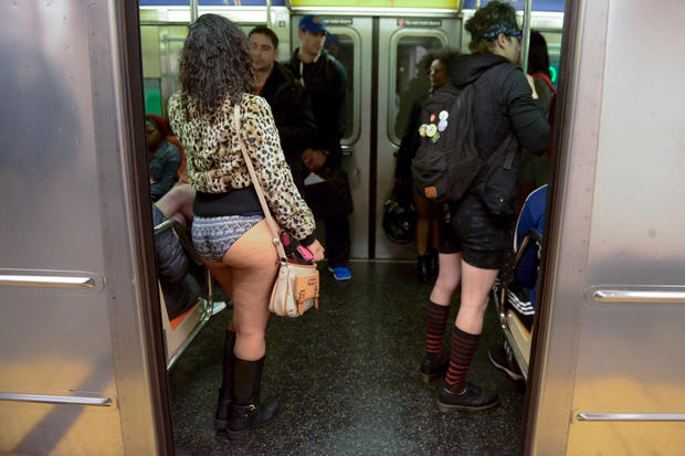 People with no pants ride the subway during the annual No Pants Subway Ride in New York, January 10, 2016. REUTERS/Stephanie Keith  - RTX21RQ1