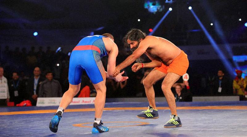 Yoga guru Baba Ramdev defeated 2008 Olympic silver medallist Andrey Stadnik