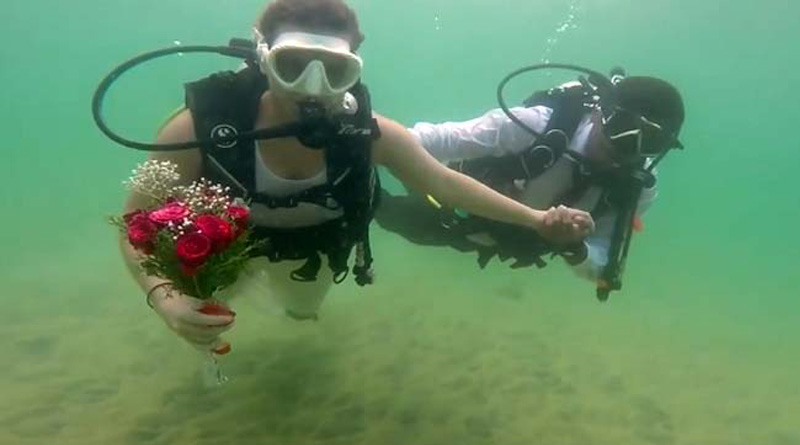 In a first, couple ties knot underwater in India