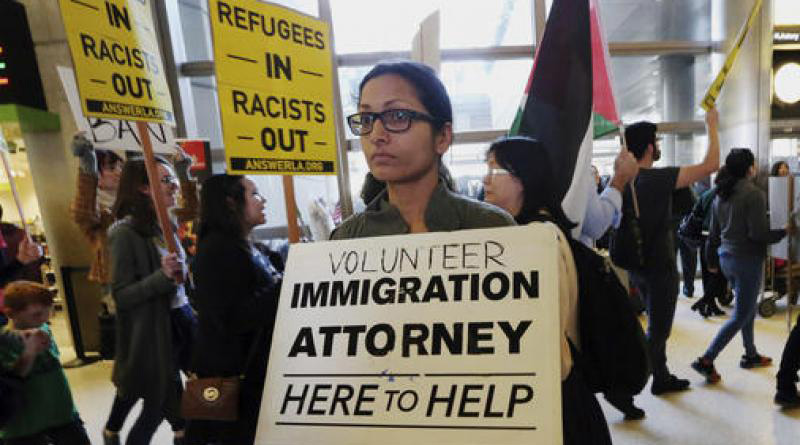 visa holders hurry to board flights to America as trumps travel ban block by Federal judge