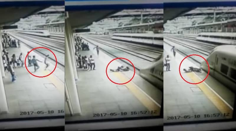 Youth braves death to save girl from being crushed under train wheels