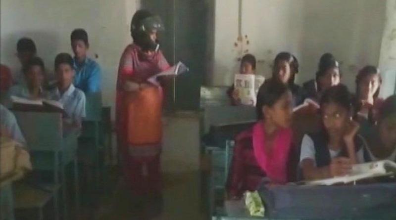 Read why Telangana govt school teachers wearing helmet at work