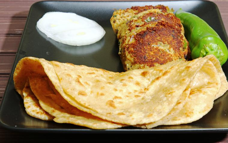 A platter of Shami kebab, made of minced chicken, goat meat, lamb or beef combined with boiled chana daal lentils , spices served with Paratha