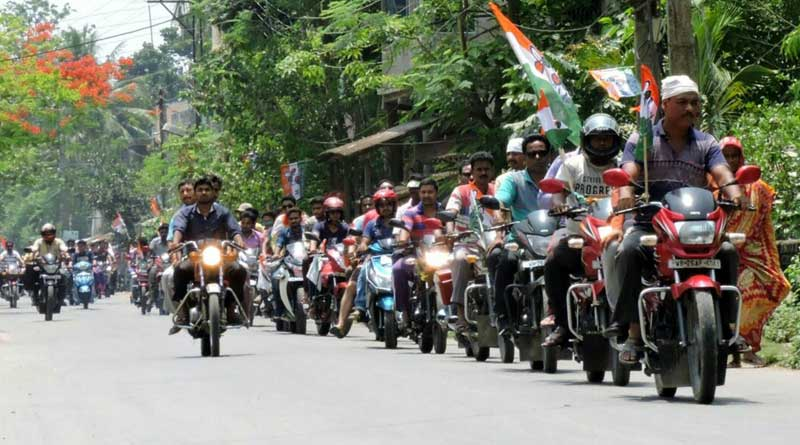 TMC workers participate in a bike rally without helmet in Bongoan