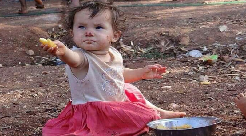 Refugee Toddler Offers Food To A Journalist