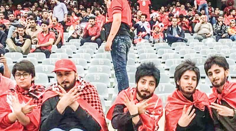 Iranian lady football fan watch match from gallary