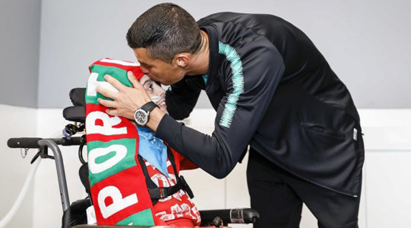 Cristiano Ronaldo meets physically challenged children during football WC practice match