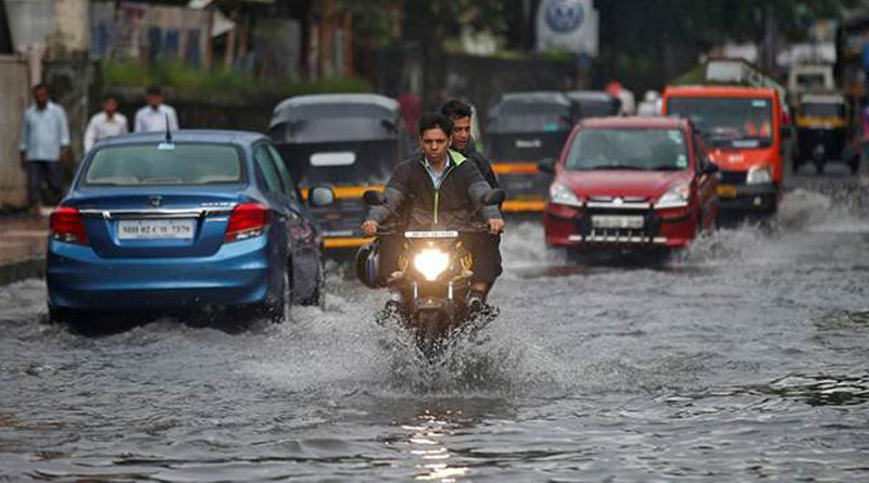 kolkata hit by heavy rain disrupting traffic in busy hours