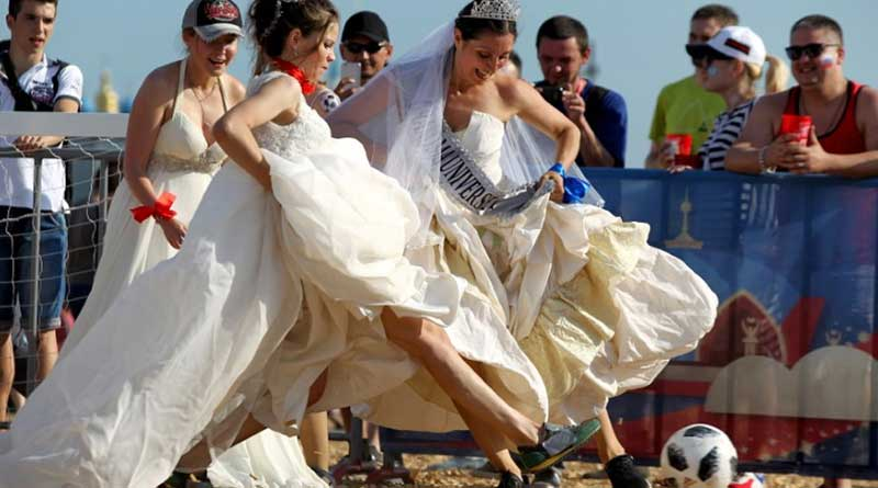 FIFA World Cup 2018: Russian women play soccer wearing bridal dresses