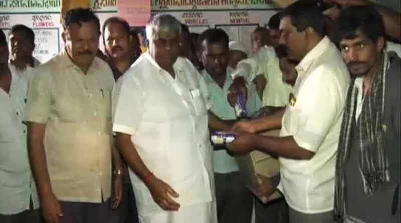 Revanna throwing biscuit packets Kerala Flood Victims, viral video
