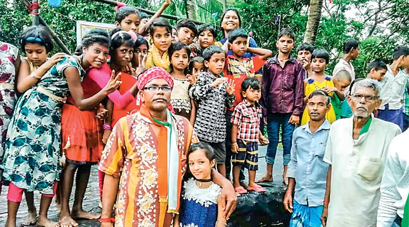 Tamluk:  group Of people give cloth to the poor For Puja