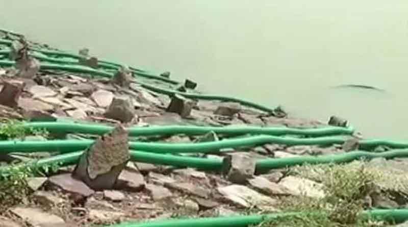 Villagers drain water from lake in Karnataka