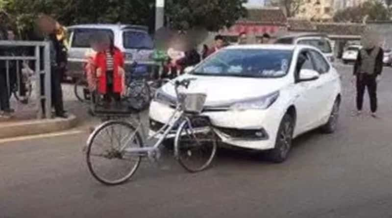 Car Damaged By Bicycle After Collision