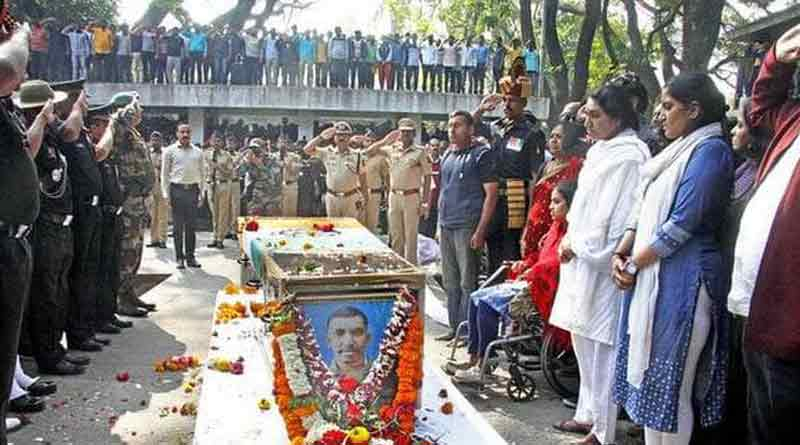 The wife of army martyr salutes captain