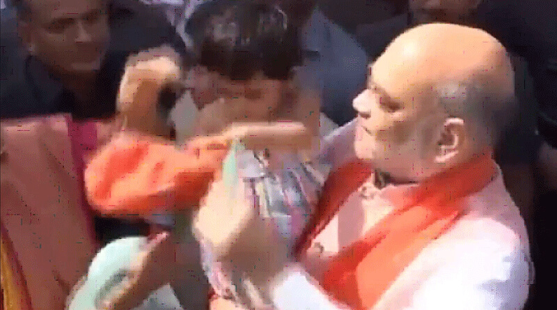 Amit Shah tries to make granddaughter wear BJP hat. She is not amused.
