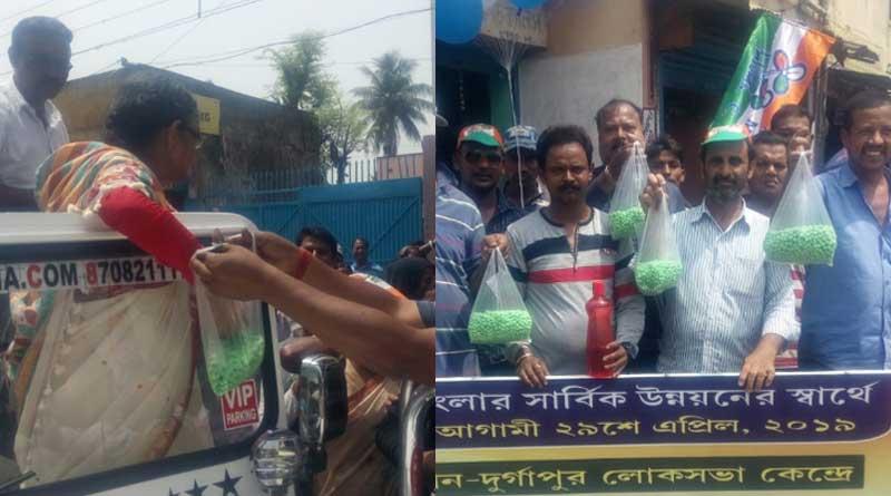 TMC candidate Mamtaz Sanghamita distributes green Nakul Dana