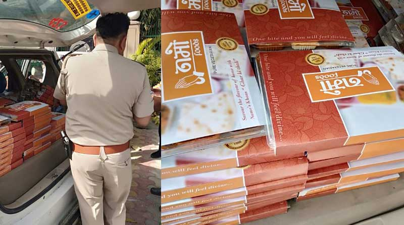 food platters sent inside poll booth with 'NaMo Food' cover on it