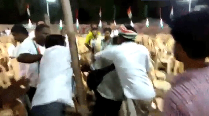 Congress workers beat up journalist for taking photos of empty chairs.
