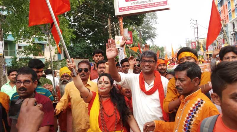 BJP candidate Kalyan Chaubey takes part in a arms rally at Krishnagar