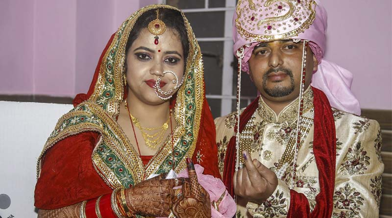 The bride and groom seen at a voting booth in Jammu and Kashmir's Udhampur