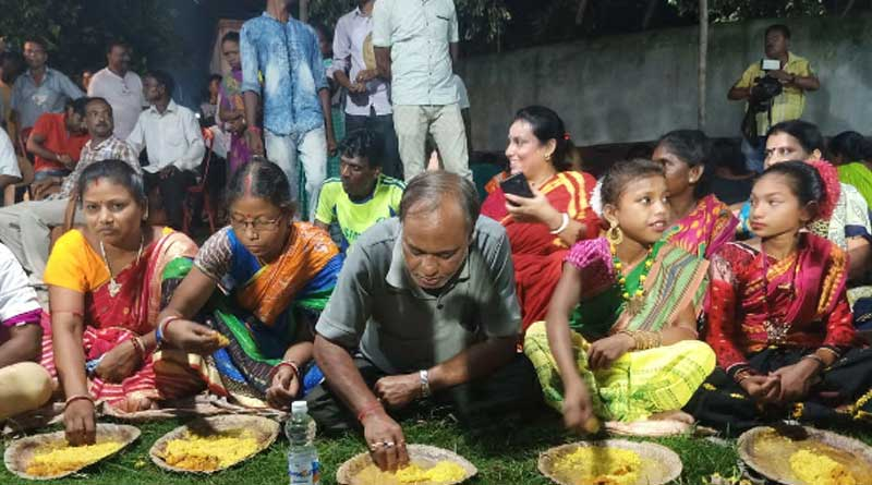 Locals welcome TMC MLA with garlands in a village at Kulti