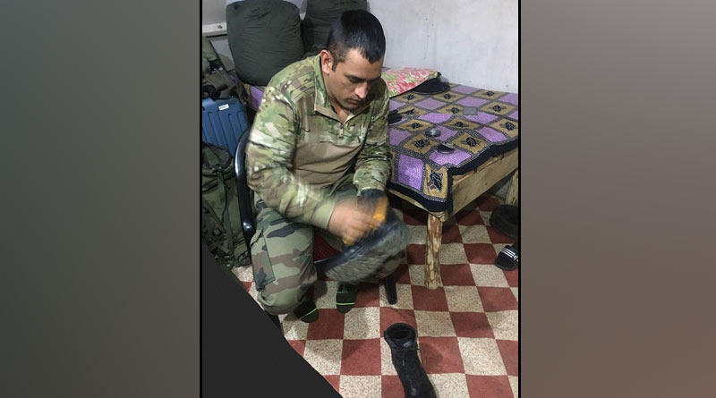 Former India Team skipper MS Dhoni polishes boot in Army camp