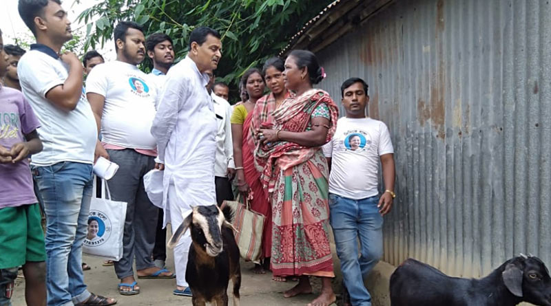 Minister Swapan Debnath communicates with tribal people in Burdwan
