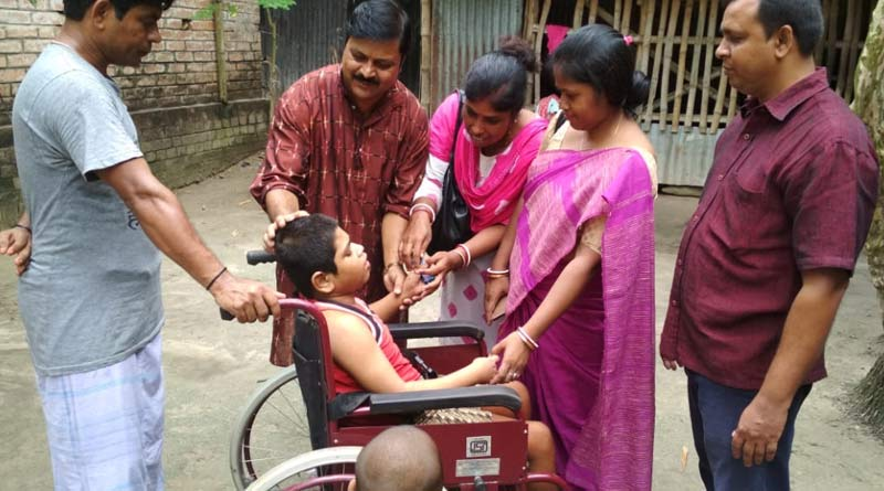 Teachers gift differently abled boy wheel chair in Nadia