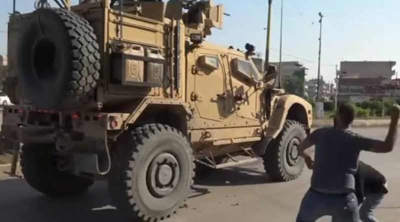Residents of Syria city throw rotten vegetables at departing US troops
