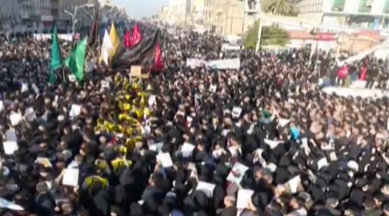 Mourners flood the streets as Qassem Soleimani's body returns to Iran