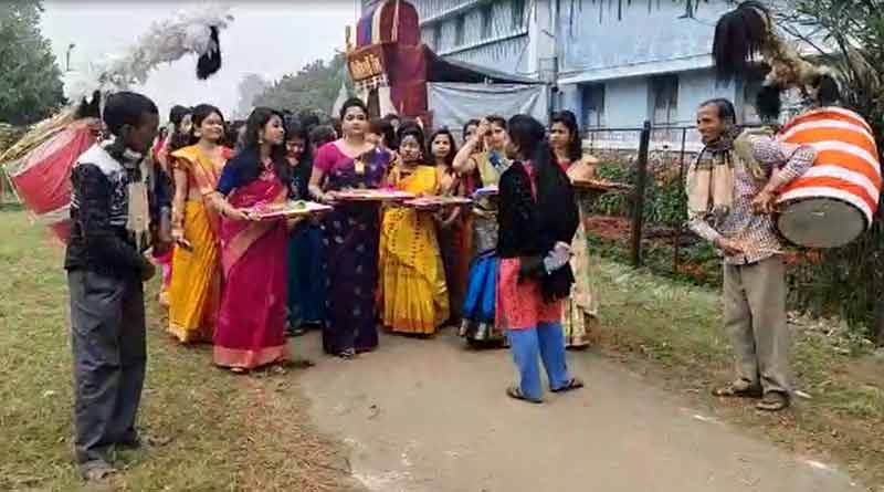 In Saraswati Puja, boys and girls students exchange gifts in Burdwan University