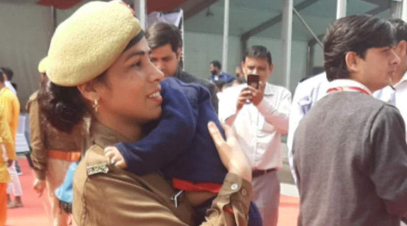 On-duty woman cop carries infant son in arms at Yogi Adityanath event