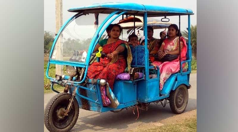 A woman from Nadia drives toto to earn for the family