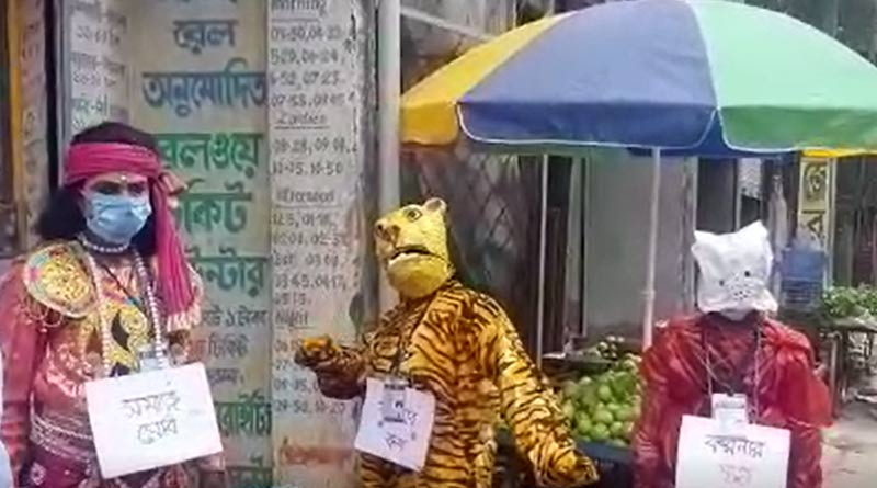 Men in disguise of Tiger and Deer campaign for Corona awarness at Canning