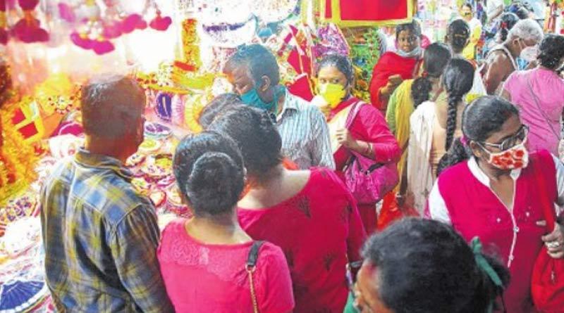 Kolkata Durga Puja news: Committees separate fund to buy masks for visitors | Sangbad Pratidin