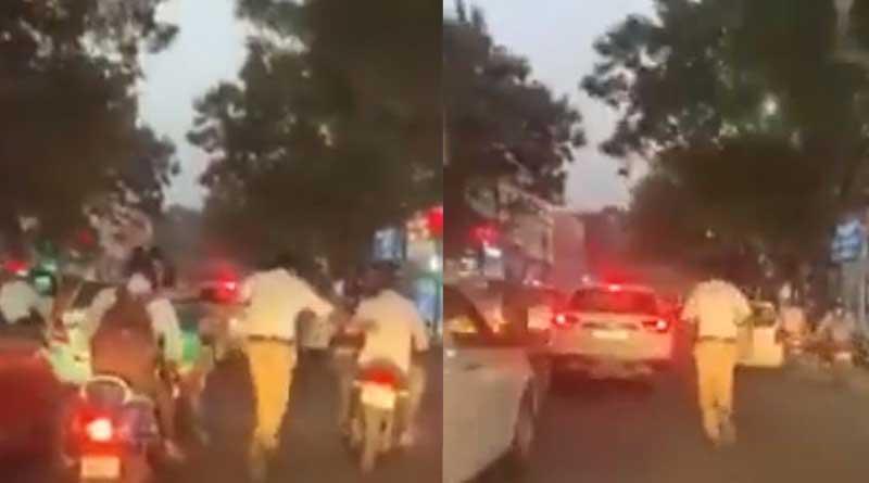 Hyderabad cop runs 2 km to clear path for ambulance, video goes viral | Sangbad Pratidin