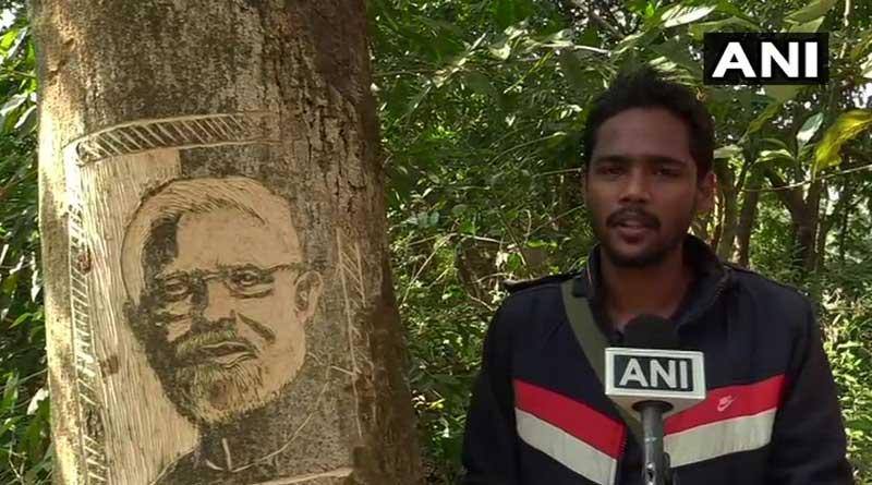 Odisha artist carves PM Modi's portraits on a tree, urges him to take note of illegal felling of trees | Sangbad Pratidin