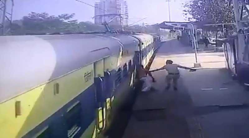 Disabled man slips while boarding moving train, Panvel RPF cop saves him. Watch video | Sangbad Pratidin
