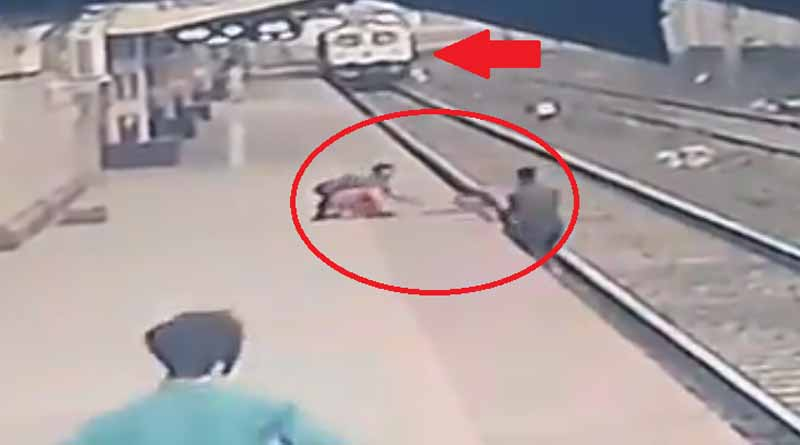 Viral video: A railway man from a station of Mumbai risked his life and saved a child's life । Sangbad Pratidin